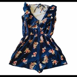 NWOT navy floral shorts romper size medium